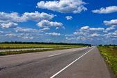 Asphalt road leaving far — Stock Photo