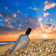Bottle on a sea coast at the sunset — Stock Photo