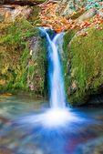 Small blue waterfall — Stock Photo