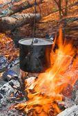 Touristic cauldron in a fire — Stock Photo