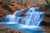 Beautiful cascade on a mountain river — Stock Photo