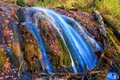Waterfall in a autumn mountains — Stock Photo