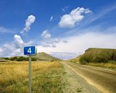 Asphaltic road get-away far — Stock Photo