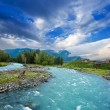 Emerald river in a mountains - Stock Photo