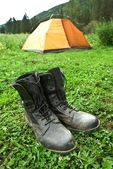 Hunters boots near the tent — Stock Photo