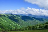 Mountains valley under a blue sky — Stock Photo