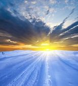 Dramatic sunset in a winter plain — Stock Photo