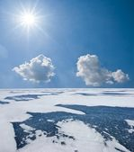 Winter frozen lake under a sparkle sun — Stock Photo