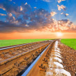 Railroad to the sunset - Stockfoto