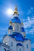 Christian church on a blue sky background — Stock Photo