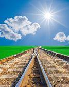 Railroad under a sparkle sun — Stock Photo