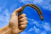 Herradura es en una mano — Foto de Stock