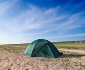 Green touristictic tent in a steppe — Stock Photo