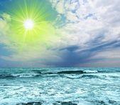 Sparkle sun above a sea coast — Stock Photo