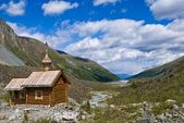 Wooden christian church in a mountain valley — Stock Photo