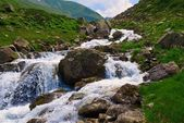 Rushing water in a caucasus mountains — Stock Photo