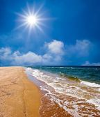 Sea coast by a hot summer day — Foto Stock