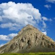 Conical mountain in a blue sky background — Stock Photo