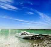 Boats in a lake near a moorage — Stock Photo