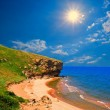 Sparkle sun above a sea bay — Stock Photo