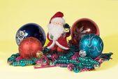 Santa Claus among fir-tree toys — Stock Photo