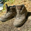 Touristic boots in grass — Stockfoto #8550947