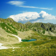 Small mountain lake with island — Stock Photo