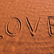 Love sign on a sand — Stock Photo