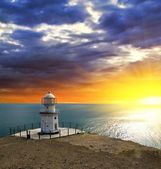 Lighthouse on a sea coast — Stock Photo