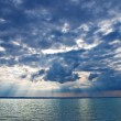 Dense clouds above sea — Stock Photo #9140731