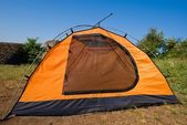 Orange touristic tent among a fields — Stock Photo