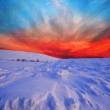 Stock Photo: Snowbound plain after sunset