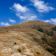 Grat hill under a blue sky - Stock fotografie