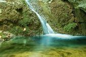 Small beautiful waterfall — Stock Photo