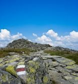Touristic mark in a mountains — Stock Photo