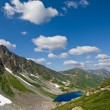 Blue lake in a green caucasian mountain valley - Stockfoto