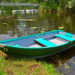 Small elegant boat on a summer river - Stockfoto