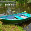 Stock Photo: Small elegant boat on summer river