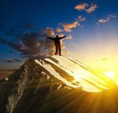 Hiker silhouette stay on a mountain top — Stock Photo