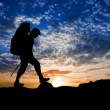 Hiker silhouette on a sunset background — Stock Photo