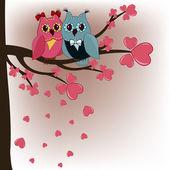 Due gufi in un amanti di albero con cuori — Vettoriale Stock