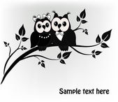 Two black and white on a black owl tree — Stok Vektör