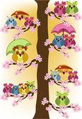 Massa ugglor som sitter i ett träd — Stockvektor