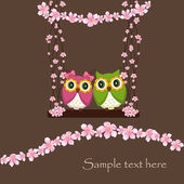 The two owls in love on a swing of flowers — Stock Vector