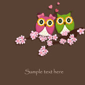 Two funny, love the owl sitting on a flowering branch — Vector de stock