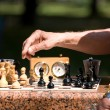 Chess board and hands — Stock Photo