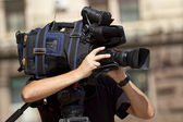 Cameraman in action — Stock Photo