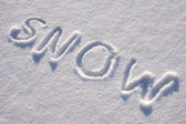 Text SNOW on the snow — 图库照片