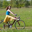 Girl goes by bicycle - Stock Photo