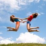 Jumping girls — Stock Photo